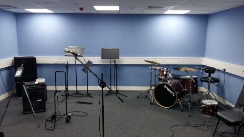 A photo of a music practice room with fabric covered acoustic walls