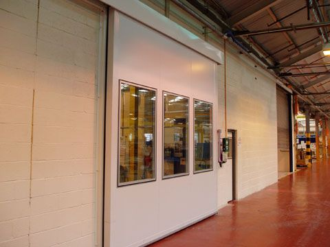 Sliding acoustic door with vision panels | on