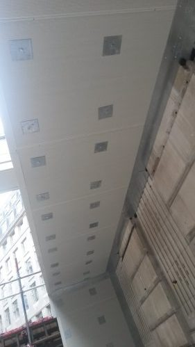 A photo of an acoustic screen attached to scaffolding on a multi-storey building in excess of 20m high