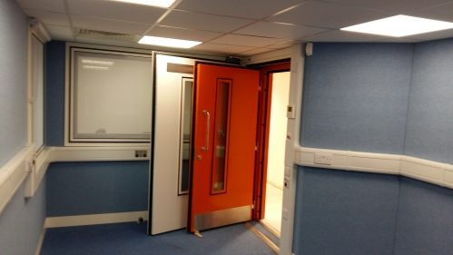 A photo of two acoustic doors operating in the same aperture